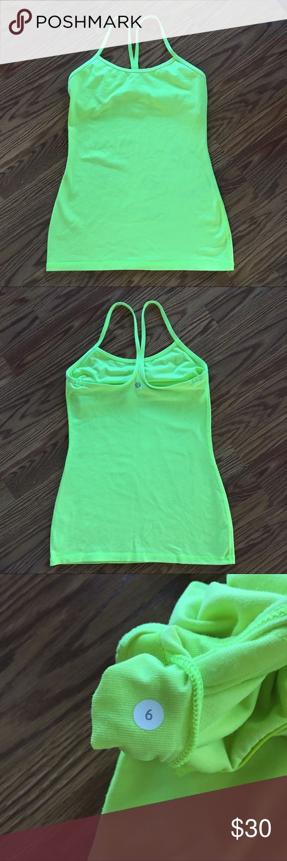 Lululemon Power Y Tank Gently used ray neon yellow power y tank. Size 6. Color is most like the last stock photo. lululemon athletica Tops Tank Tops