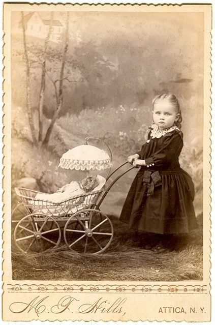 little lady with her doll and carriage