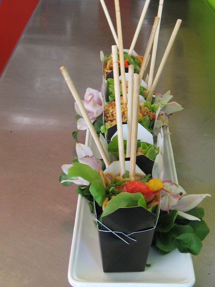 I love displaying salads in mini chinese take out boxes. The presentation is always fun and clients are always thrilled with the presentation.  Featured here is my Thai Noodle Salad.