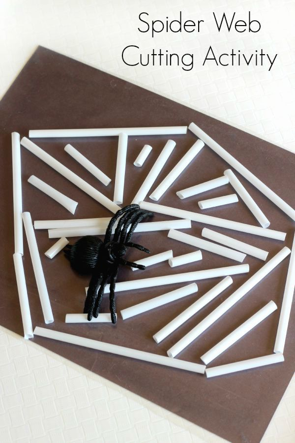 Spider web cutting activity for preschoolers. A scissor skills activity with straws and contact paper.