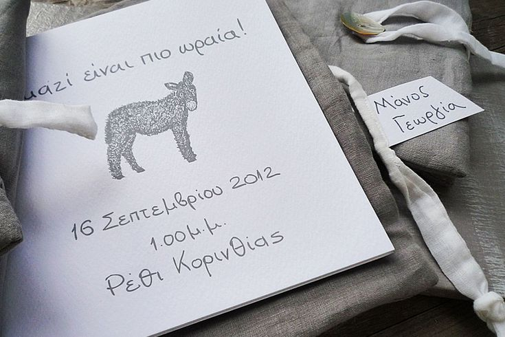Handwritten baptism invitation booklet with grey linen cover