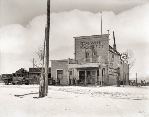 """April 1936. """"Grocery store in Widtsoe, Utah. FSA land use project purchase area and clients who will be removed to more desirable section."""" Medium format negative by Dorothea Lange for the Resettlement Administration."""