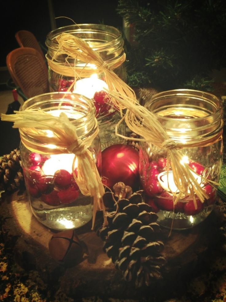 christmas table centerpiece  mason jars  floating candles  u0026 cranberries  red ornaments  pine