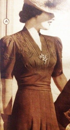 1930s Day Dresses,- Trapunto detail on upper bodice and sleeve, decorative pin vintage fashion style photo print ad women ladies dress short sleeves 30s 40s