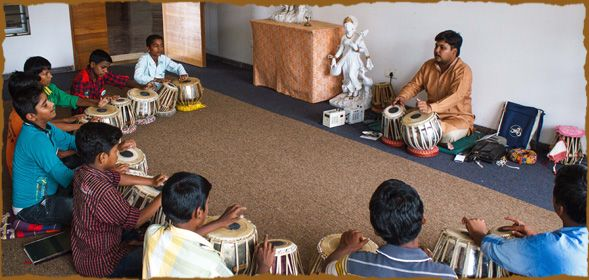 CNB Faculty Rohit Kulkarni conducts a Tabla class for Chinmaya Social Repsonisbility students during the Summer Arts Intensive at Chinmaya N...