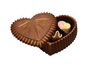 Шоколадное сердце Съедобное шоколадное сердечко из вкусного молочного бельгийского шоколада с 3 конфетами внутри. Вес - 205 г. http://www.aimant.ua/collections/product/milk_chocolate_heart
