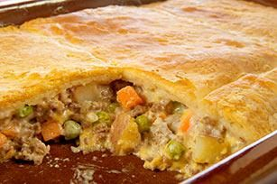 VELVEETA Easy Cheesy Pot Pie recipe - Ground beef and vegetables in a cheesy sauce are baked in a casserole topped with refrigerated crescent dough for a taste-tempting pot pie.