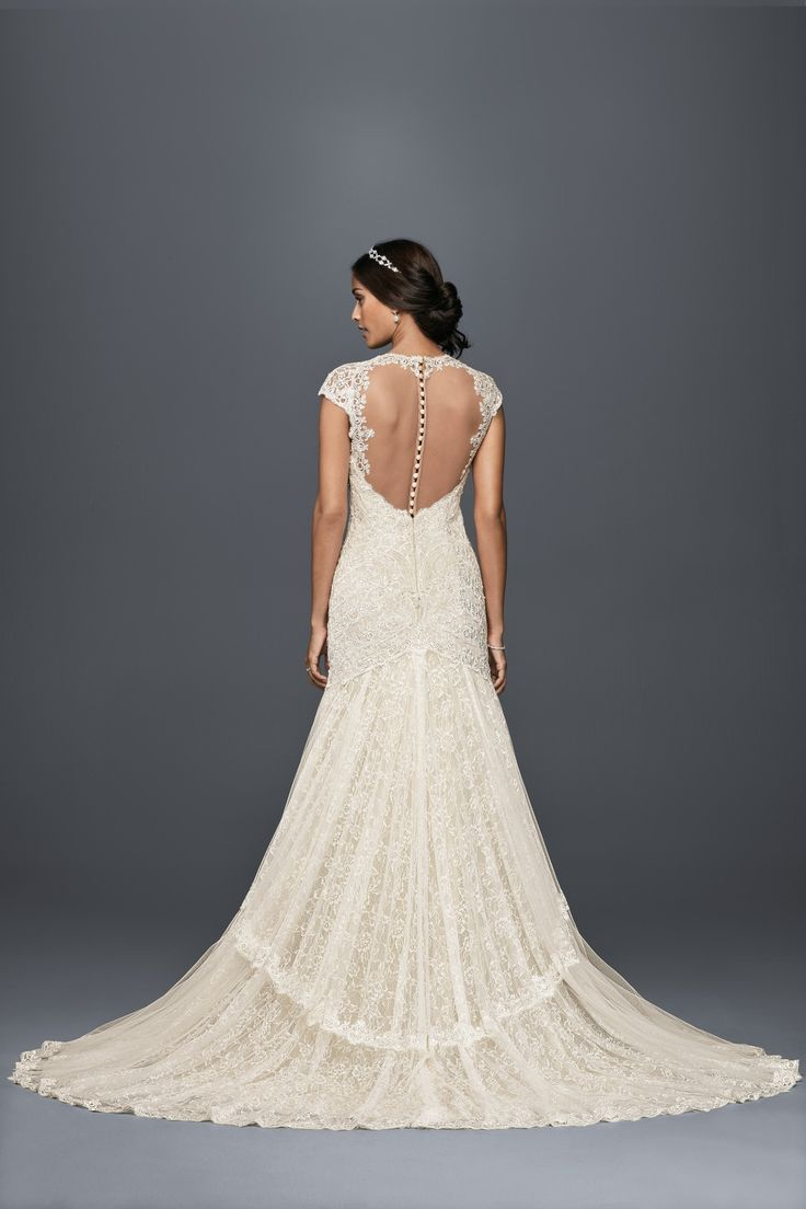 Romantic lace and illusion details for your vintage wedding ceremony. Cap Sleeve Sweetheart Neckline Tiered Lace A-Line Wedding Dress by Melissa Sweet available at David's Bridal