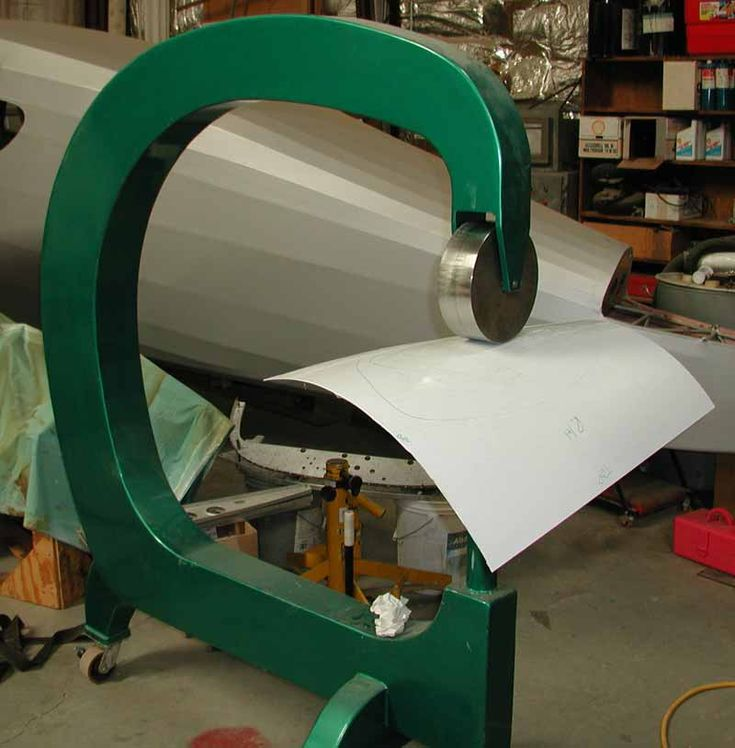 An English wheel used to make compound curves on sheet metal. A necessity.