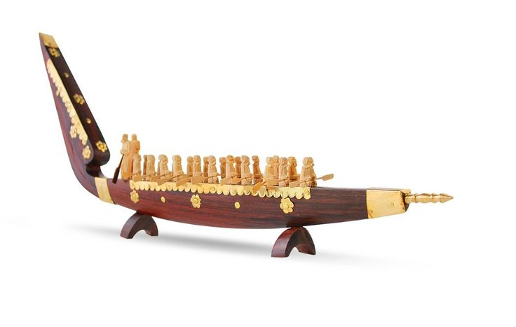 The miniature model of Snake Boat with rowers and brass embellishments is a popular handcraft product of Kerala #miniature #modelboats #wooden