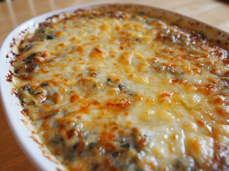The only Spinach artichoke dip recipe you will ever need - #pickyhusband approved.   To minimize (by a trivial amount) the naughty, you can ditch the 1/2 cup Monterey Jack cheese on top (Parmesan only). EVIL GOOD.