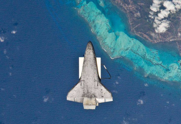 Earth Day 2010 - Photos - The Big Picture - Boston.com: The underside of space shuttle Discovery is visible in this image photographed by an Expedition 23 crew member on the International Space Station soon after the shuttle and station began their post-undocking relative separation on April 17th, 2010. The recognizable feature on Earth below is the south end of Isla de Providencia, about 150 miles off the coast of Nicaragua.