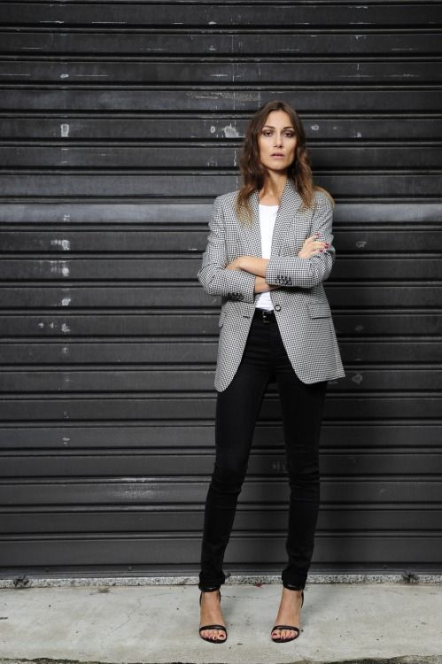 Shop this look on Lookastic:  http://lookastic.com/women/looks/black-heeled-sandals-black-skinny-jeans-white-crew-neck-t-shirt-black-and-white-blazer/7467  — Black Leather Heeled Sandals  — Black Skinny Jeans  — White Crew-neck T-shirt  — Black and White Houndstooth Blazer