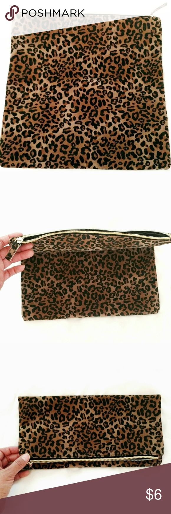 Leopard fabric clutch Leopard fabric clutch from Red Dress boutique, roughly 12 x 12 in. Un folded, 6 x 12 when folded. Brown lining, gold zipper, no tag for fabric content. Used twice, in excellent condition, like new. Red Dress Boutique Bags Clutches & Wristlets