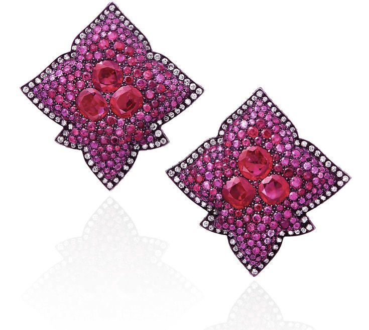 JAR Paris. A PAIR OF RUBY AND DIAMOND EARRINGS, BY JAR. Of stylised foliate design, pavé-set with circular-cut rubies, each centering three circular and oval-shaped larger rubies, within a diamond surround, 1989, 4.0 cm, mounted in silver and gold, in pink leather JAR'S pouch. One earring signed JAR Paris. Price realised USD 338,569.17 // Estimate USD 100,000 - USD 150,000 [C. Magnificent Jewels - 14 November 2017 - Geneva] #JARParis #JoelArthurRosenthal
