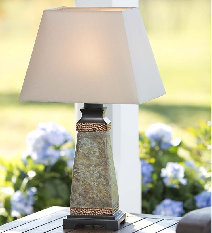 Our weatherproof slate outdoor table lamp has a gorgeous slate base highlighted with hammered faux copper accents a versatile solution for patio p