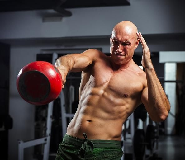 Sportive Man Workout With Kettlebell Doing Lunges. Stock