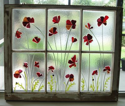 Fused Glass Red Poppy Petals and Ladybugs set in an Antique Window Frame.