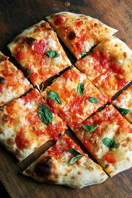 Homemade pizza at its very best - fresh tomatoes, basil, cheese and caramelized onions....yum!