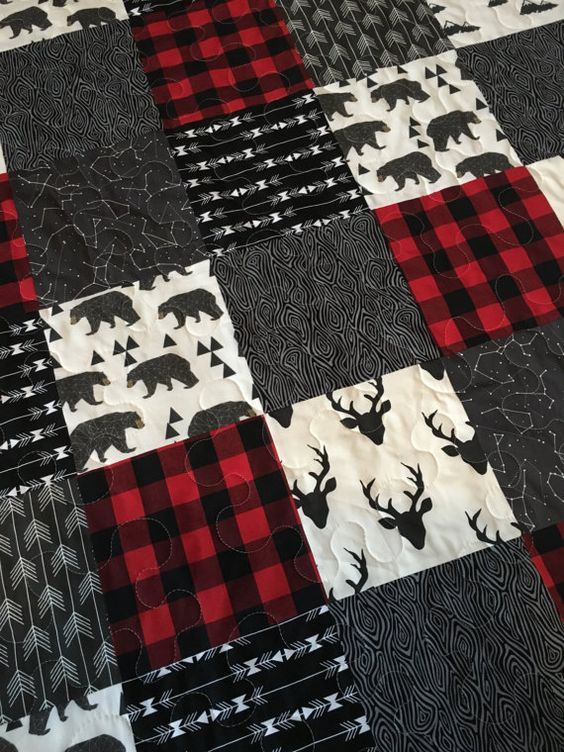 This item is ready to ship! Baby Boy Quilt-Rustic Baby Quilt-Deer Baby Quilt-Baby Boy Crib Bedding-Woodland-Buffalo Red Plaid-Bear-Arrow-Trees-Modern Baby Blanket This handmade quilt is made from a variety of high quality designer fabrics. The designs included feature deer, bear, arrows, and a classic red buffalo plaid. It would be a perfect addition to any rustic modern nursery theme! It is constructed with three layers, with a natural cotton batting in the middle. I have used a…