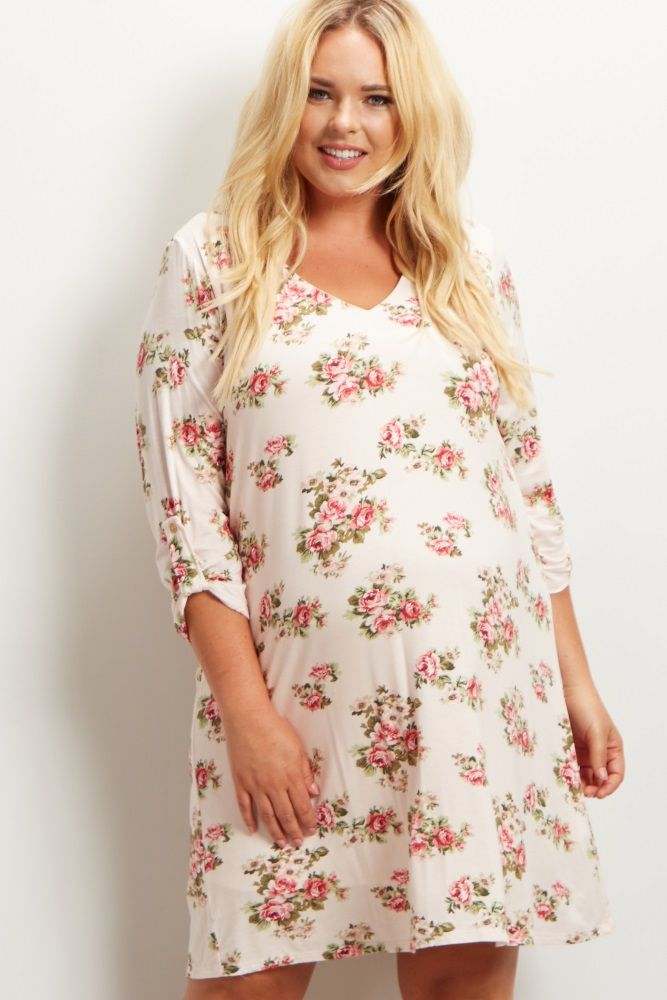c8707e2ba0fbe A printed plus maternity dress. Rounded v-neckline. Double lined to prevent  sheerness. 3/4 roll tab sleeves.
