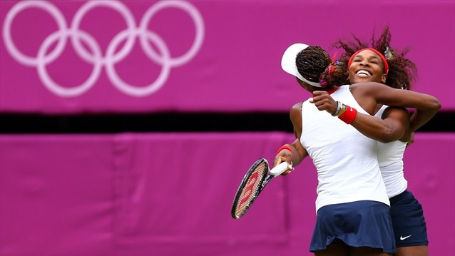 Williams sisters celebrate Doubles gold