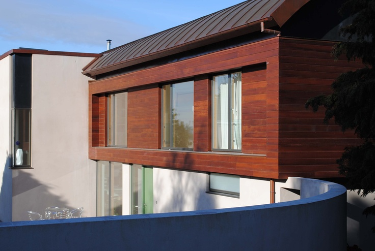 Our house in Nairn that we re-modeled. Existing 1970's wood clad house was re-clad in Cedar and extended.