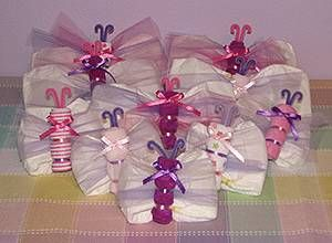 Diaper ButterfliesEach Butterfly is Decorated with  Colored Tulle and Ribbon.  No Glue or Tape Has Been   Used To Make These Butterflies, So  They Are Completely Usable   Once They Are Disassembled