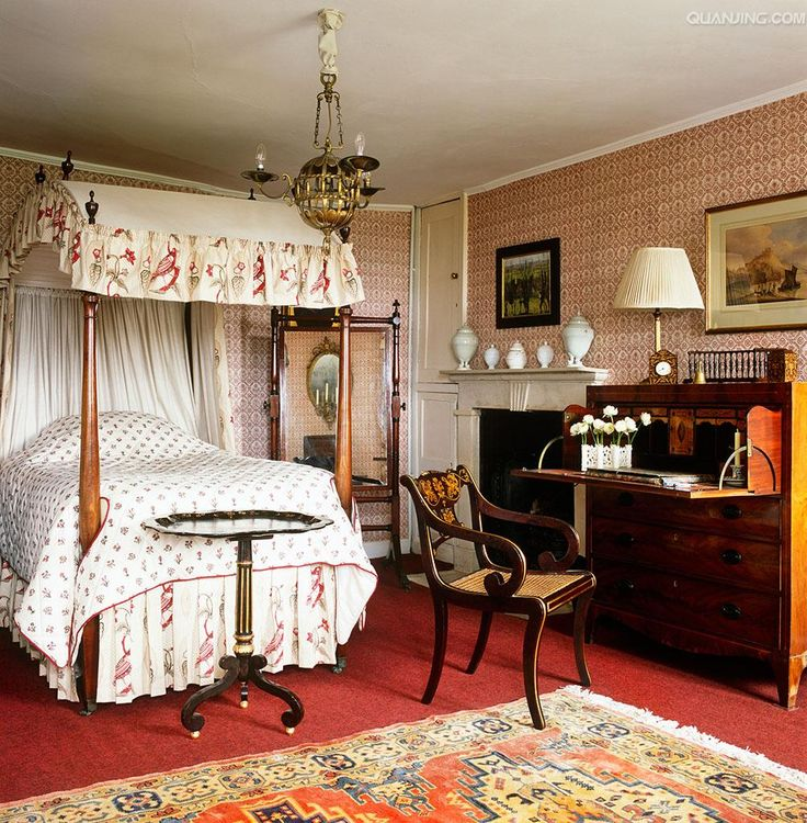 pink print canopy & paper mix with mahogany fold down desk in this English bedroom in Gloustershire