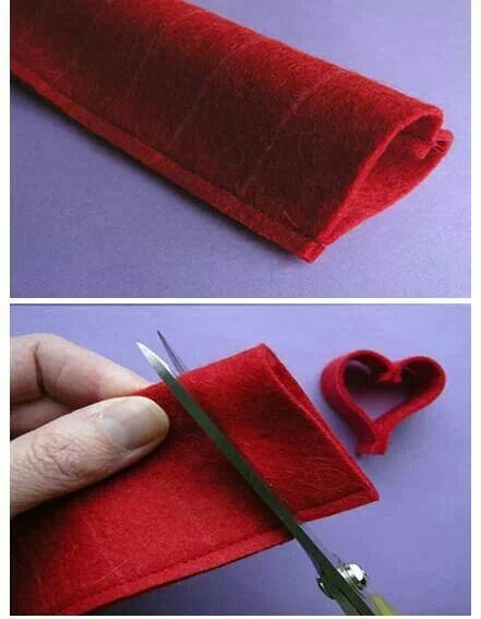 What a cute felt IDEA, and easy way to make a garland of hearts for Valentine's Day! I could also alter it to make a little Christmas tree one or even ornaments ... snowflakes ...