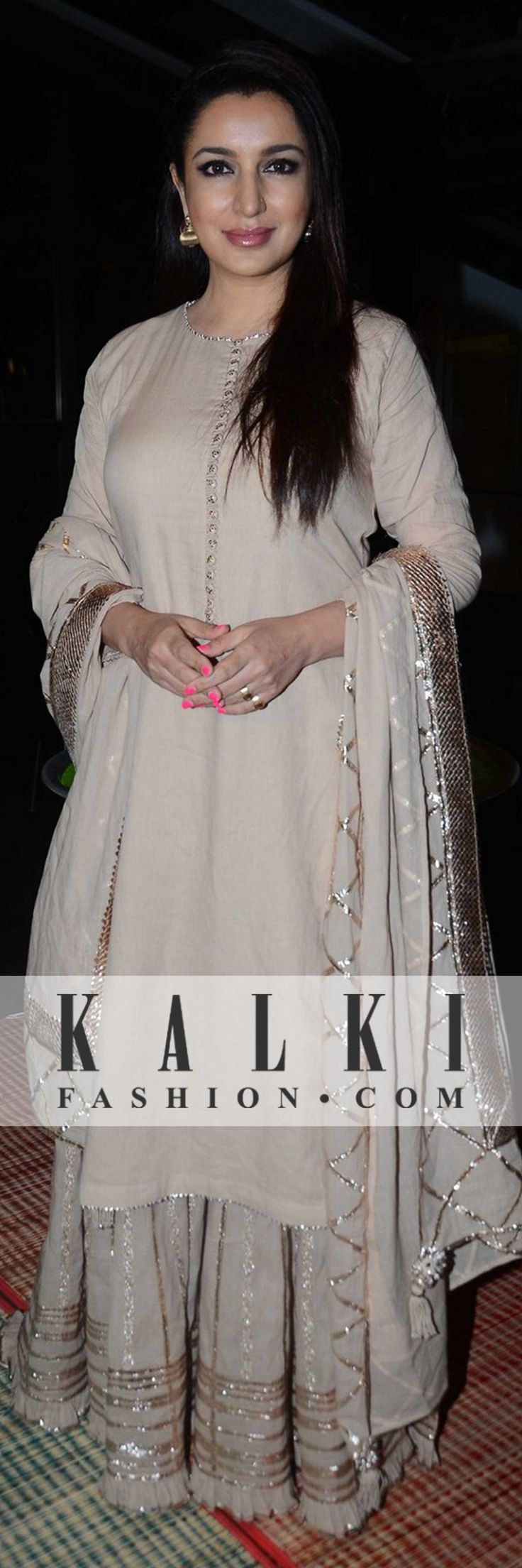 Tisca Chopra - Captured in a beige palazzo with golden gota work suit, she had all eyes on her. Shop Indian Couture at www.kalkifashion.com
