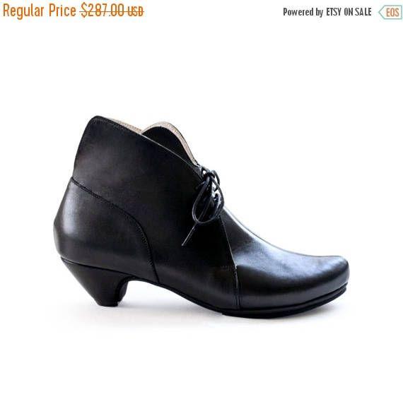 50% vrouwen schoenen. Zwarte enkel laarzen zwarte hakken
