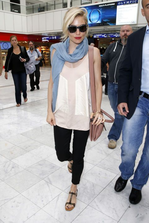 Use a colored scarf like Kate Bosworth does here to add instant polish to a white top and black pants ensemble. See 6 other celebrities whose spring style killed it.