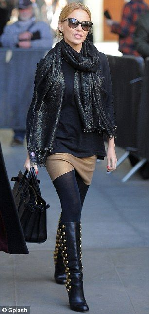 Fit for a pop princess: Kylie looked ready for action in a miniskirt with black studded boots