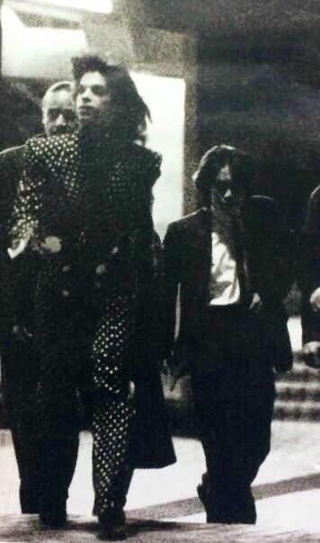 Prince • 1989 Lovesexy Tour - Prince arriving in Tokyo Japan for the last leg of the tour. Note the reverse polkadot suit by that time!