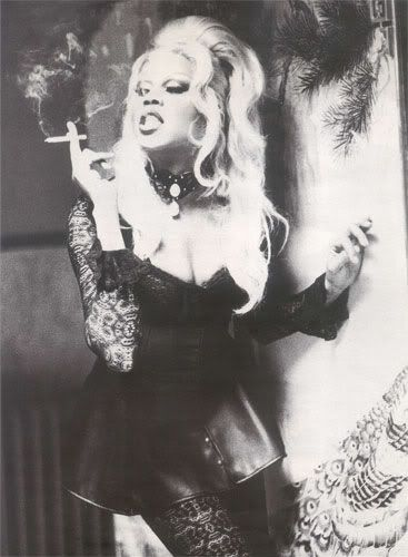 RuPaul smoking a cigarette (or weed)
