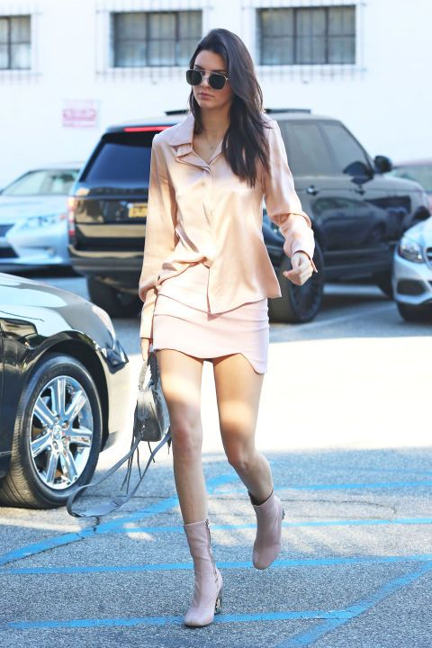 Kendall Jenner looks every bit pretty in pink in this all-over blush ensemble—but she's adding a bit of spice to the sweet look, too. The model, who admittedly loves to go braless, gives a subtle flash of her infamous nipple ring in this silky sheer blouse, making our cheeks turn a similar flushed hue.