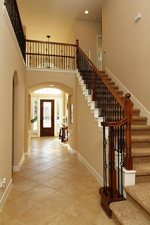 Dramatic Staircase W Wrought Iron Detail Second Floor