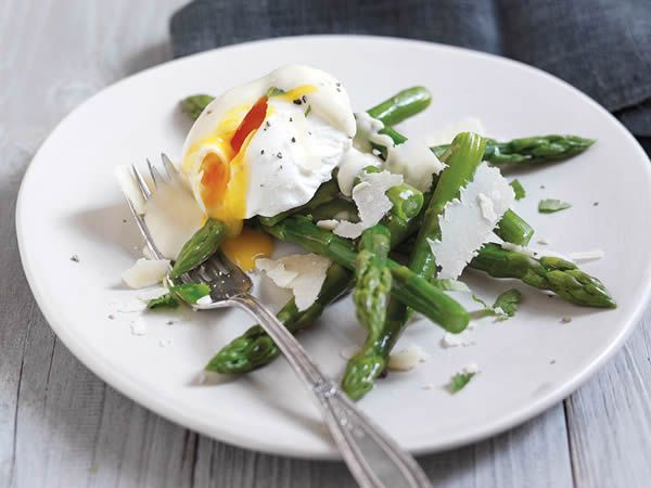 Asparagus with poached eggs and Parmigiano Reggiano sauce http://www.eatout.co.za/recipe/asparagus-poached-eggs-parmigiano-reggiano-sauce/