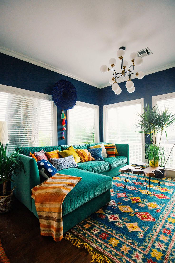 dreamy space with navy walls and colorful rug