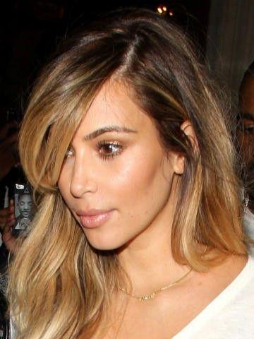 "Kim Kardiashian and Kanye West are both rocking name necklaces with their daughter's nickname, ""Nori"""