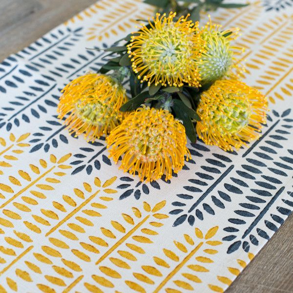 Hand made Block Print Table Runner | The Woven Trail.  Sunshine fern fabric in yellow and blue printed on linen with yellow pincushion flowers on top
