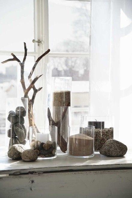I have always collected rocks, shells, twigs, etc. The contrast with the darker and light from windows and curtains is my kind of decorating. I'll be ready when I have my beach house some day!