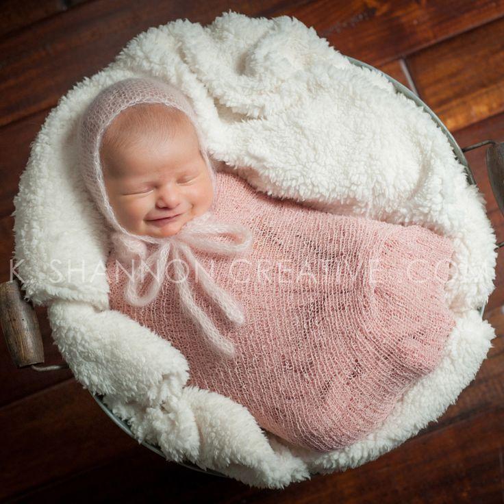Smiling newborn baby girl in a bucket! How sweet is that little smirk? www.kshannoncreative.com
