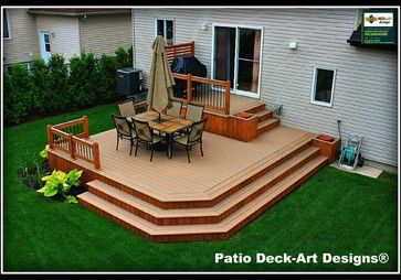 This deck flows nicely into the yard! Would love this out the back door of a home!