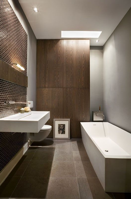 Tribeca Apartment - Bathroom - by David Howell Design. Love the fact that the toilet is off the ground.