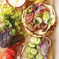 Savory sliced sirloin steak wrapped in a soft pita with veggies, Greek-style yogurt, and flavorful spices. Click on the image for Sliced Steak Gyros.