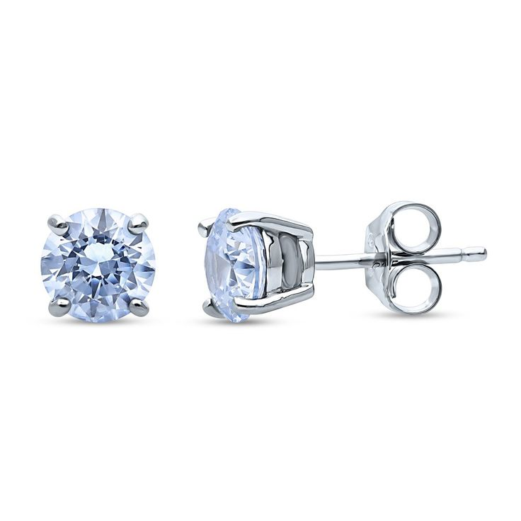 These solitaire stud earrings offer a breathtaking reminiscent of the mysterious yet intriguing deep blue sea in their greyish blue color.  Made of rhodium plated fine 925 sterling silver. Set with 1.68 carat round cut greyish blue Swarovski zirconia (6mm) in 4-prong setting. Earrings measure 0.23 inch in width, 0.23 inch in diameter. Center posts with butterfly backs.