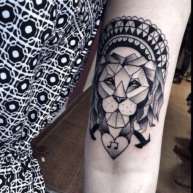 Lion tattoo by Mateus Wojtak - woman arm tattoo - tattoo artist