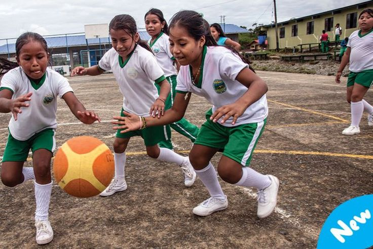 a group of girls playing soccer